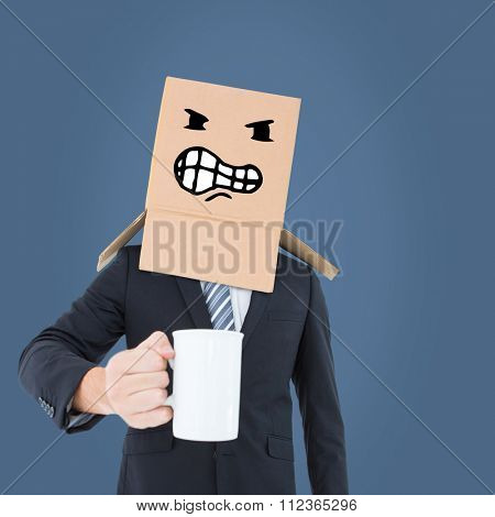 Anonymous businessman with mug against blue
