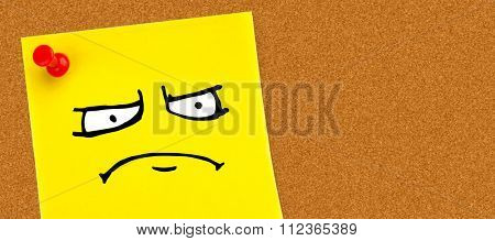 Angry face against digital image of pushpin on yellow paper