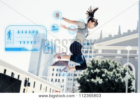 Woman doing parkour in the city against fitness interface