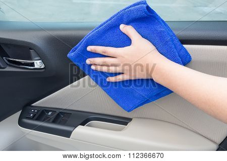 Concept Of Hand Cleaning Interior Car Door Panel With Microfiber Cloth