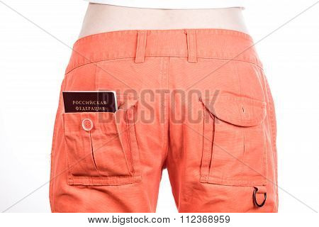 Back view of female buttocks in orange pants