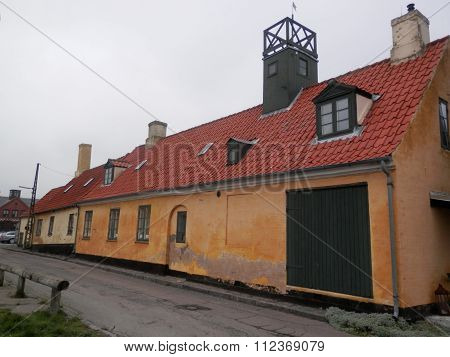 Yellow House With Red Tiled Roof