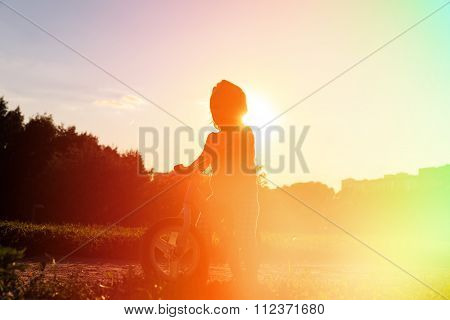 little girl riding bike at sunset, active kids
