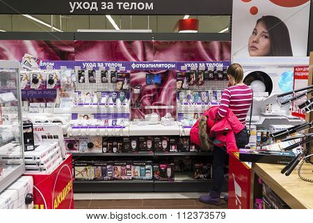 Khimki, Russia - December 22 2015. Women choose  epilator in Mvideo large chain stores selling elect
