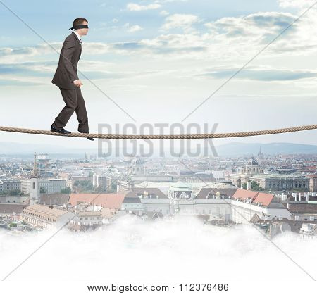 Man with closed eyes softly walking on rope