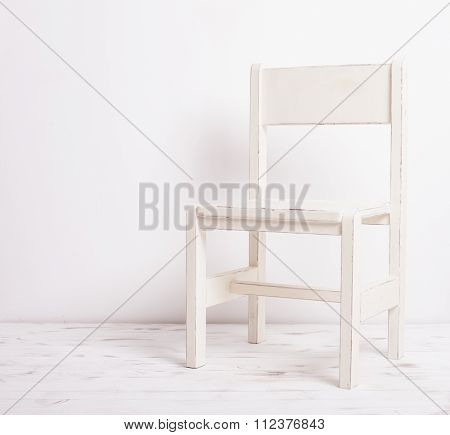 White old-fashioned chair