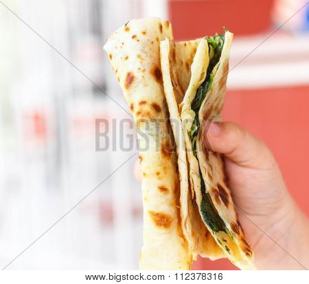 Gozleme. Turkish flatbread with greens. Shallow depth of field