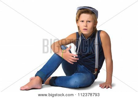 Cute blonde agresivny boy or teenager in full length casual style blue jeans posing isolated on whit