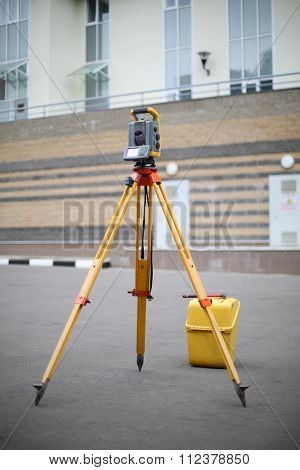 Total Station on the pavement in front of a residential building