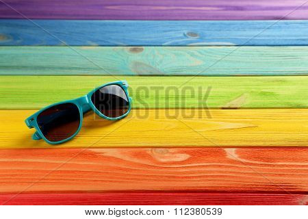 Sunglasses On A Coloful Wooden Table