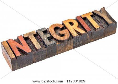 integrity  word abstract - an isolated banner in vintage letterpress wood type blocks stained by color inks