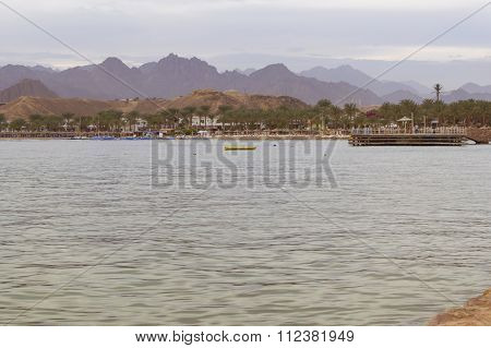 Wooden Pier On The Beach In The Evening In Sharm El Sheikh