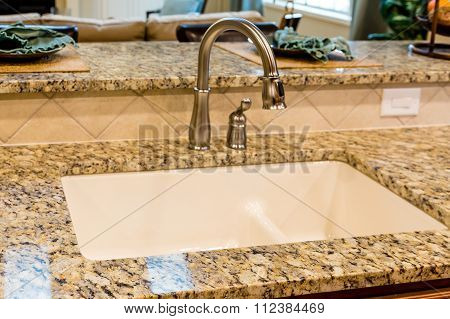 New Plumbing Fixtures On Granite Countertop