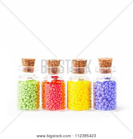 Colorful beads in the bottles