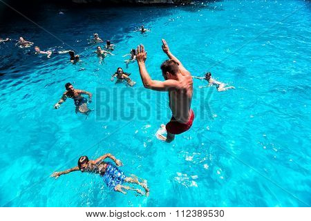 Tourists Enjoying The Clear Water Of Zakynthos Island, In Greece. Navagio Beach Is A Popular Attract