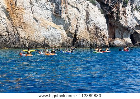 Tourists Enjoying The Clear Water In Their Canoes At Zakynthos Island, In Greece.
