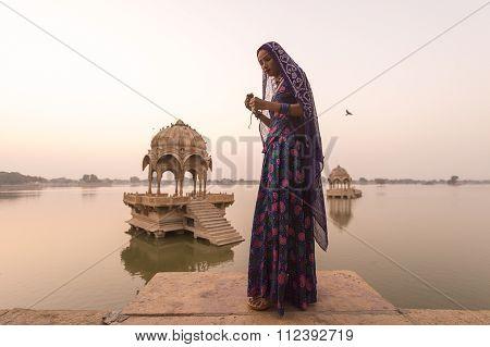 Jaisalmer, India-november 24, 2015:unidentified Local Women Standing In The Gadisar Lake