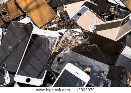 Stack Of Damaged Smart Phone Body And Cracked Lcd Screen