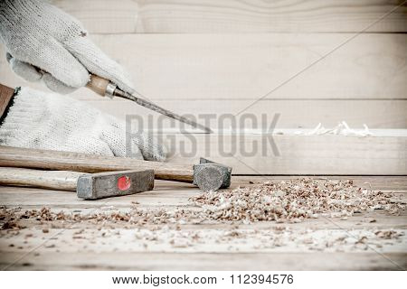 Carpenter Working With Old Plane