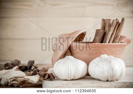 Spices And Flavorings On Wood Background.