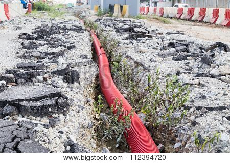 Underground Trench With Sewage Piping At Infrastructure Construction Site
