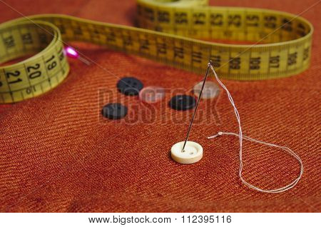 Orange Scarf And Sewing Tools