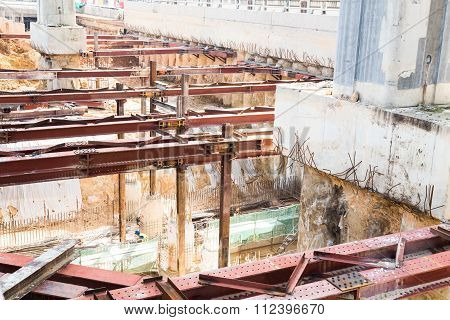 Closeup On Construction Digging Of Tunnel Underpass With Metal Beams