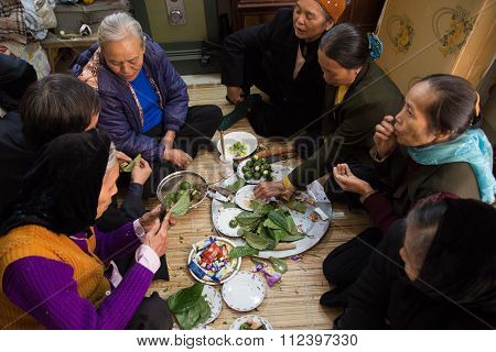 Asian elders preparing betel and areca for a Vietnamese traditional wedding ceremony