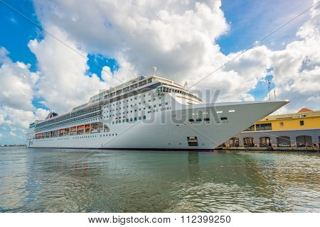 HAVANA,CUBA - DECEMBER 22,2015 : The MSC Opera cruise ship docked at the port of Havana showing the tourist boom the island has experienced in 2015