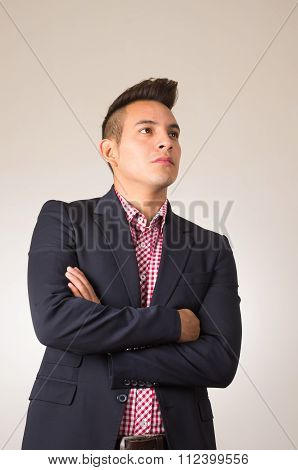 Hispanic male wearing shirt and blazer jacket arms crossed white background