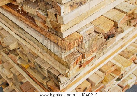 Stack Of Lumber In Logs Storage Closeup