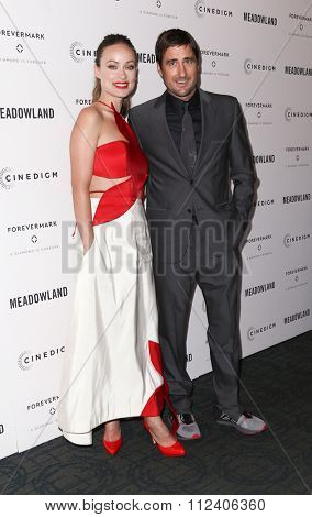 NEW YORK-OCT 11: Actors Olivia Wilde (L) and Luke Wilson attend the premiere of 'Meadowland' at Sunshine Landmark on October 11, 2015 in New York City.