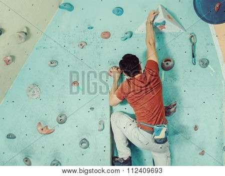 Man Climbing Artificial Boulder
