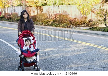 Mother walking with her disabled son