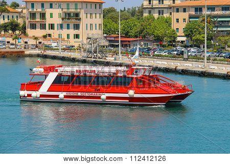 Passenger Pleasure Boat In Portoferraio Harbour, View From The Sea. Elba Island, Tuscany, Italy