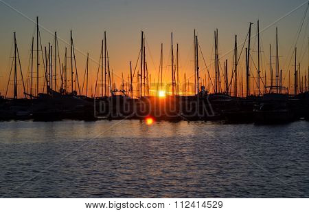 Montenegro's Harbor On Sunset, Silhouettes Of Sailboat  In The Port In The Evening