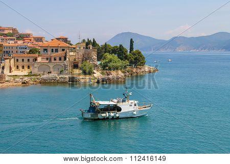 Small Boat In The Waters Of The Tyrrhenian Sea. Portoferraio From The Sea, Elba Island, Tuscany, Ita