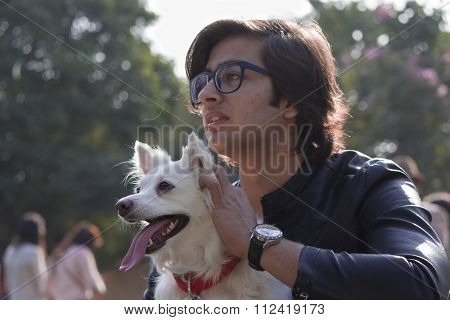 A Guy With German Spitz Dog