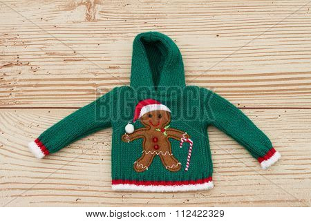 Green Gingerbread Hoodie Christmas Sweater On A Weather Wood Background