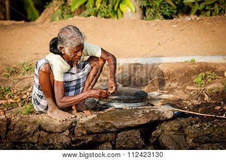 Old Woman Fishing in Kerala South India