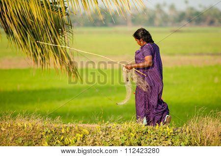 Woman Fishing in Kerala, India.