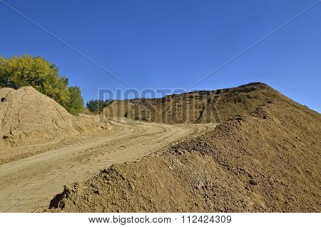 Road on a sand pile
