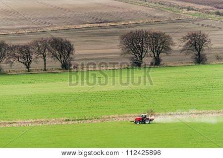 Tractor During A Fertilizer Treatment.