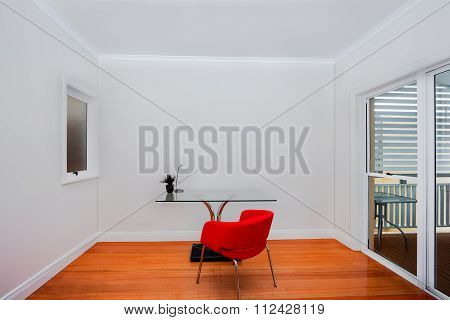 Glass Table And A Red Chair