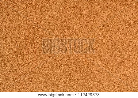Orange Stucco Relief On The Wall Of The House. Backgrounds And Textures