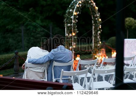 Beautiful Sensual Romantic Couple Sitting At Wedding Aisle In Th