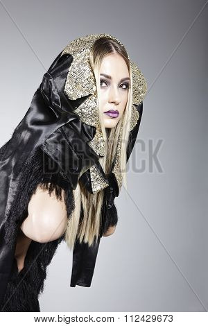 Attractive Model Wearing A Jacket On Her Head