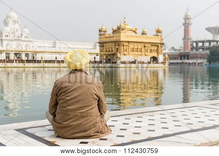 A Lone Male Sikh Pilgrim At Golden Temple,  Amritsar.