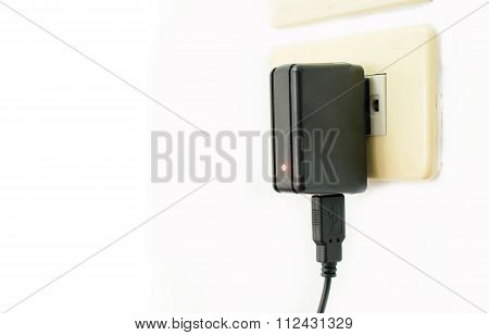 Mobile Phone Charger On Electric Outlet