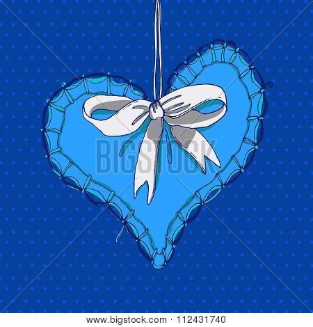 Blue hand drawn heart with white bow